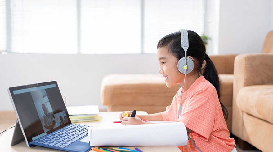 Child using computer for online learning