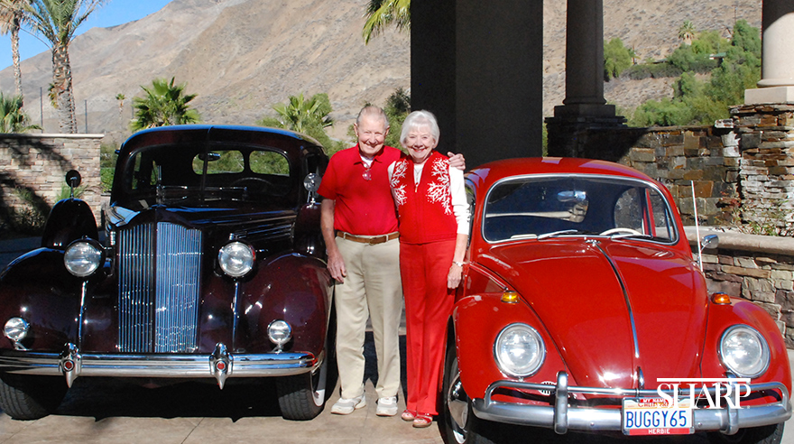 Ken and Lavinia Brass with their 1938 Packard and 1965 Volkswagen Beetle