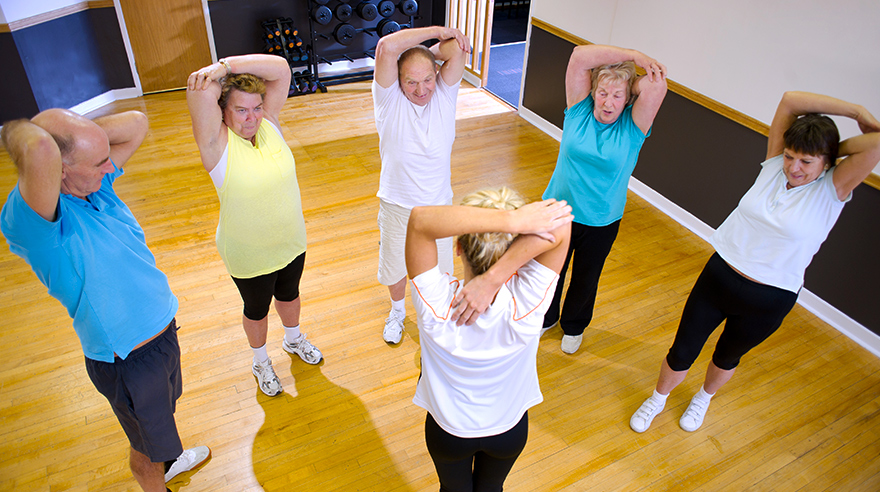 Older adults stretching at a class