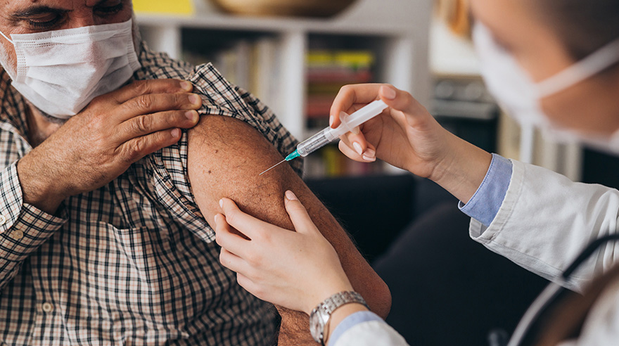 Doctor gives coronavirus vaccine to an older adult