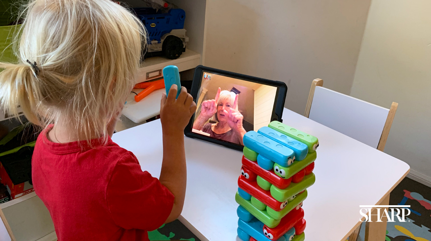 Child on a virtual call with grandmother