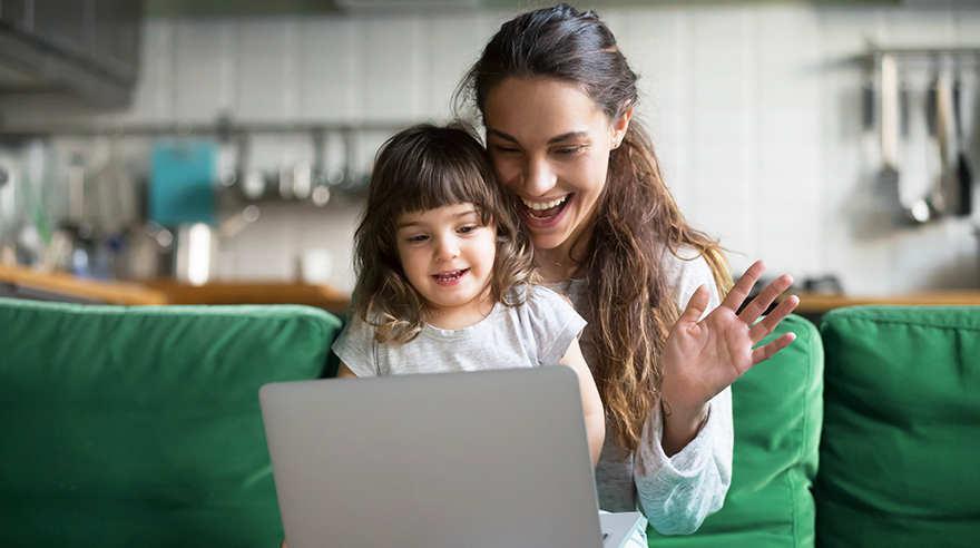 Mother and daughter looking at a laptop screen