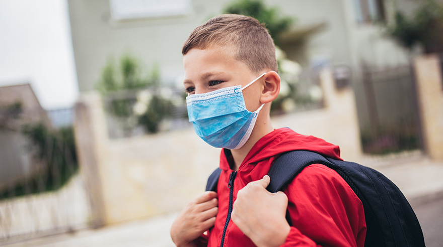 The boy wearing a mask before going to school preventing outbreak of coronavirus.