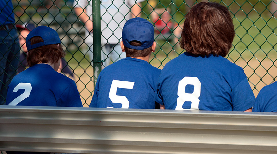 Baseball players sitting on the bench
