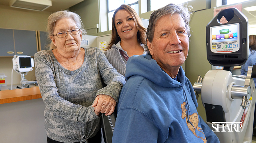 Jacquelyn Ayers (left), Kurt Mengel (right) and pulmonary rehab specialist April Brohamer (center)