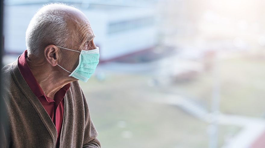 Senior in hospital wearing a mask
