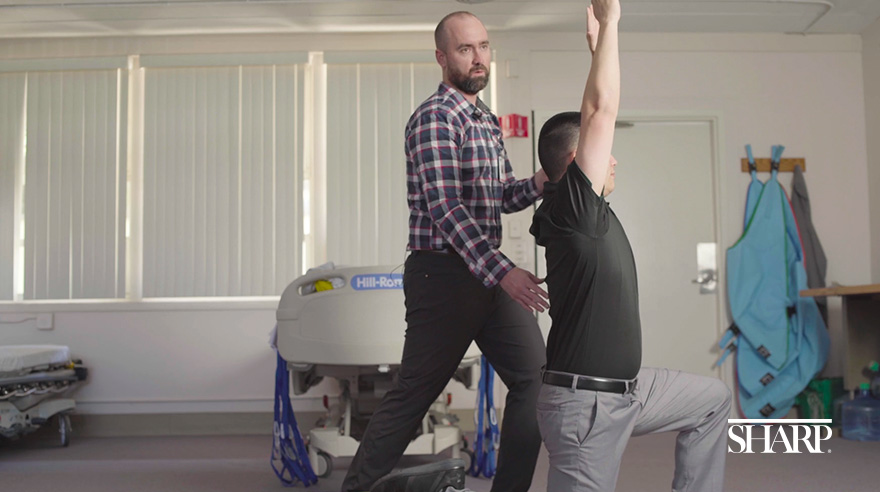 Jared Brown, a physical therapist at Sharp Grossmont Hospital, demonstrates a stretch that target the muscles in the low back.