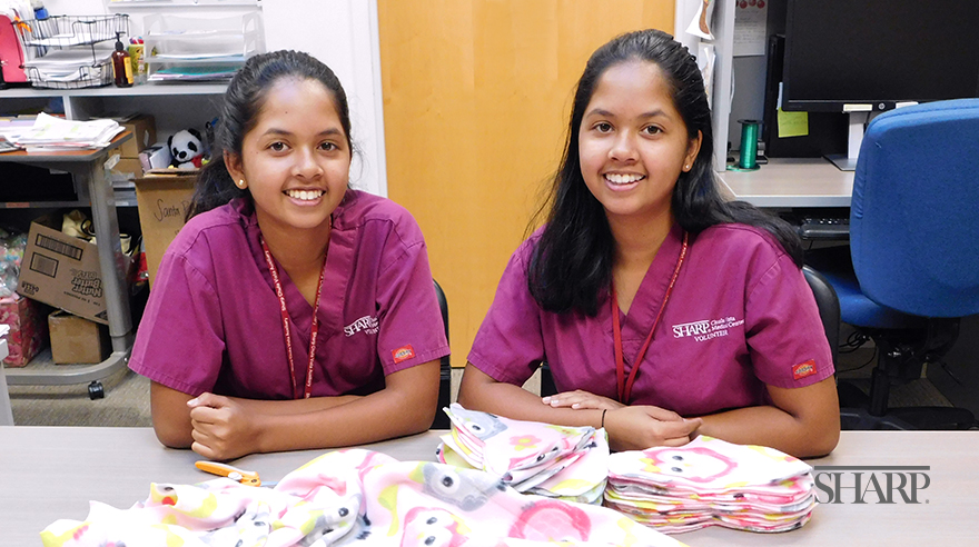Twins share desire to make a difference in their community