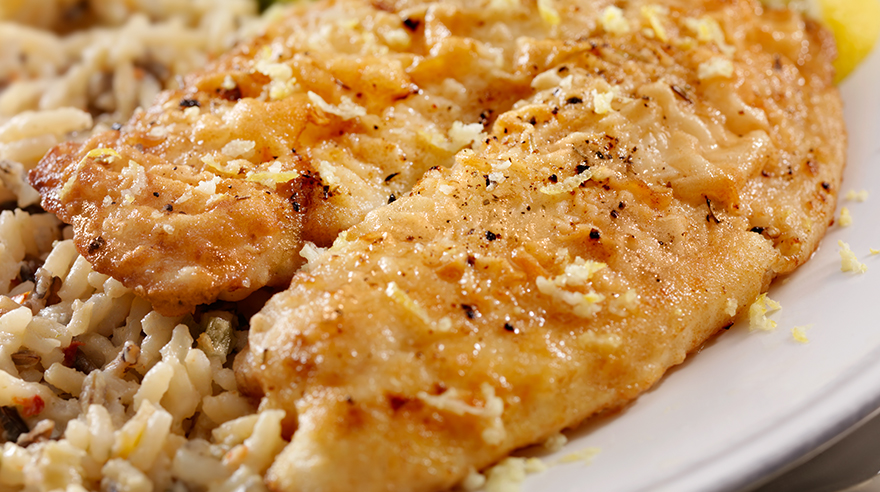 Sweet pan-seared tilapia with golden rice (recipe)