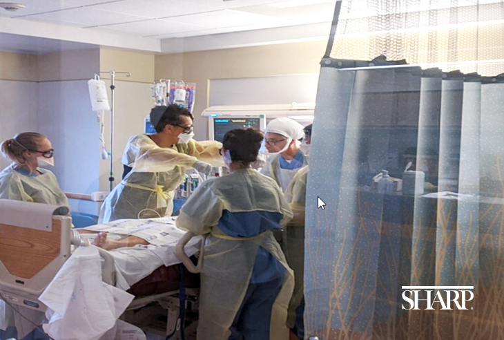 A team in the medical intensive care unit (MICU) at Sharp Chula Vista Medical Center practices the manual patient proning procedure.